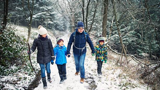 Father with children hiking in a forest