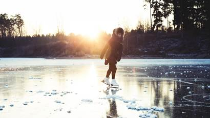Girl skating on lake