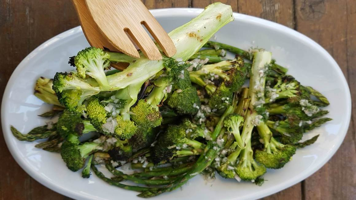 Plate of grilled broccoli and asparagus