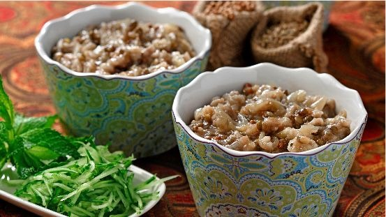 Cooked lentils and mushrooms in bowls with shredded cucumber