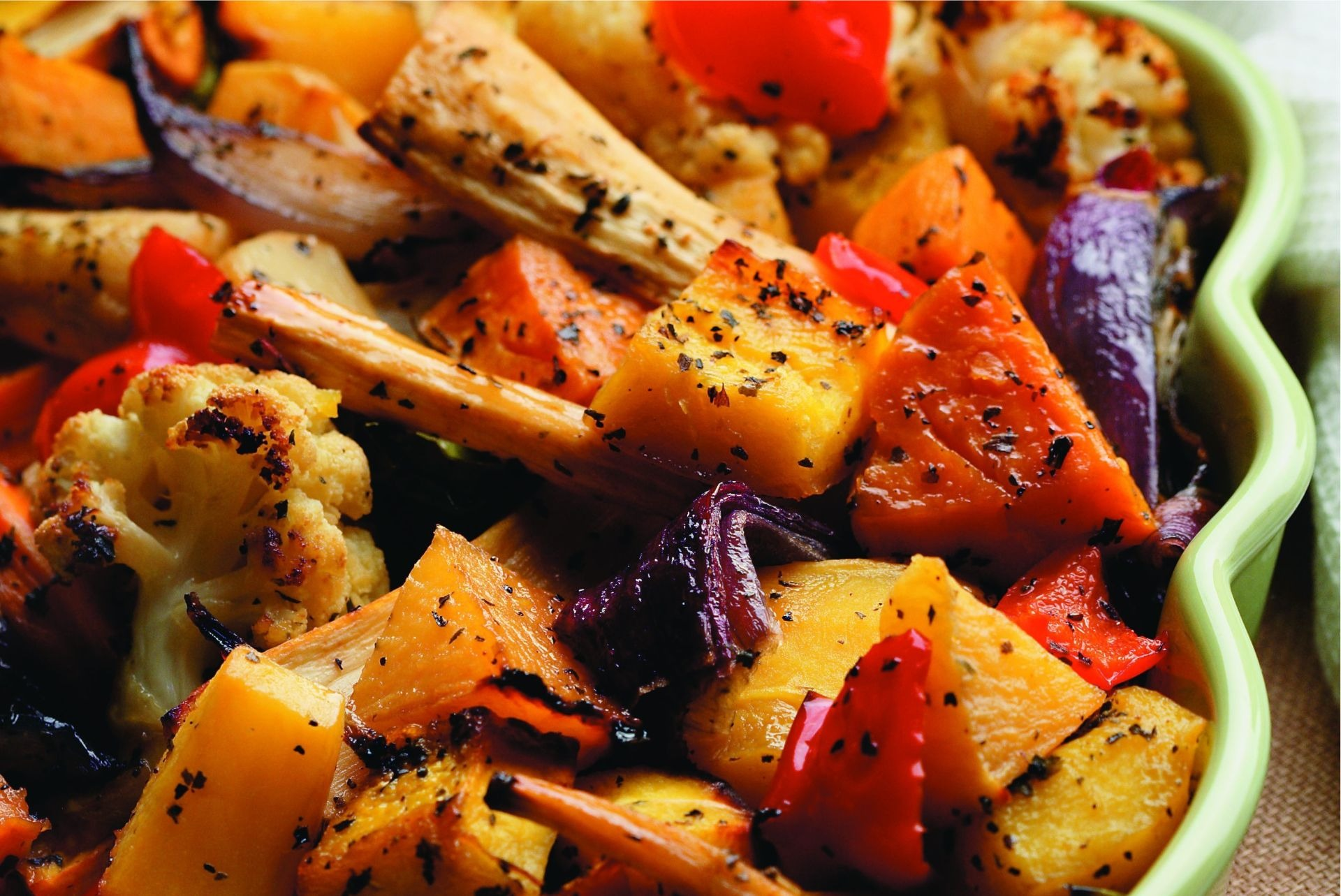 Roasted red pepper, squash, sweet potato, carrot and cauliflower in a casserole dish
