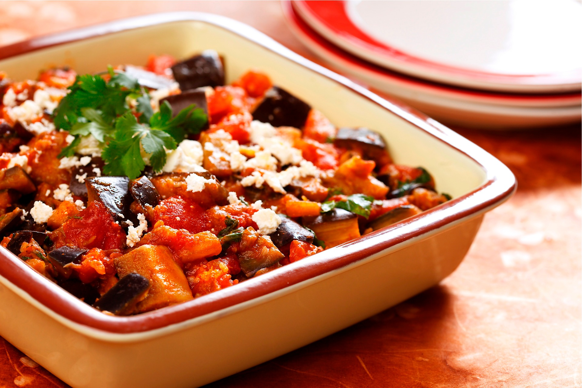 Roasted eggplant, tomatoes and feta cheese in casserole dish