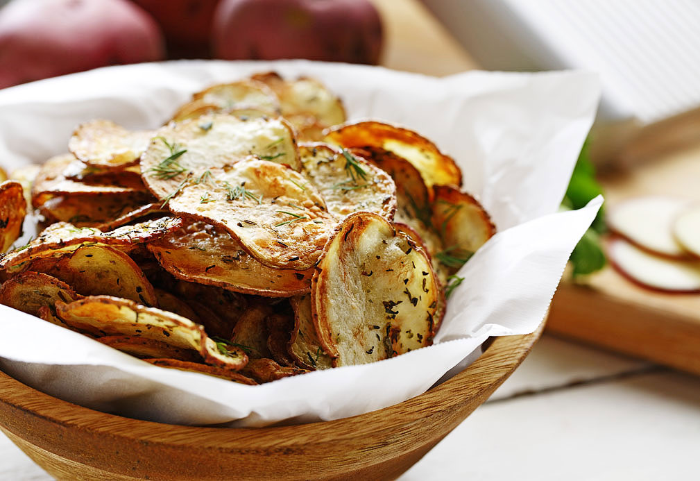 Bowl filled with oven baked potato chips
