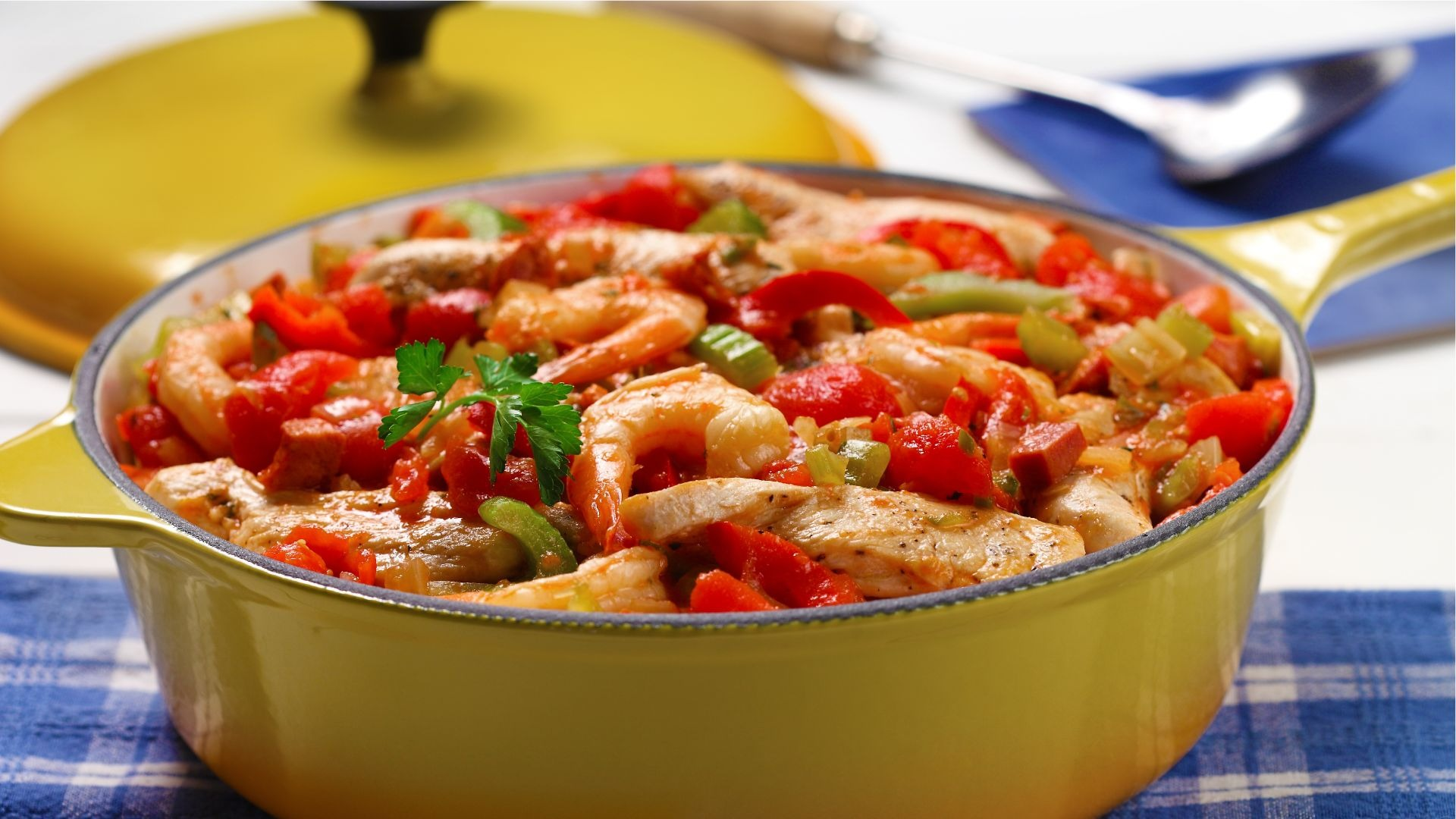 Casserole cooked shrimp, peppers, chicken and celery