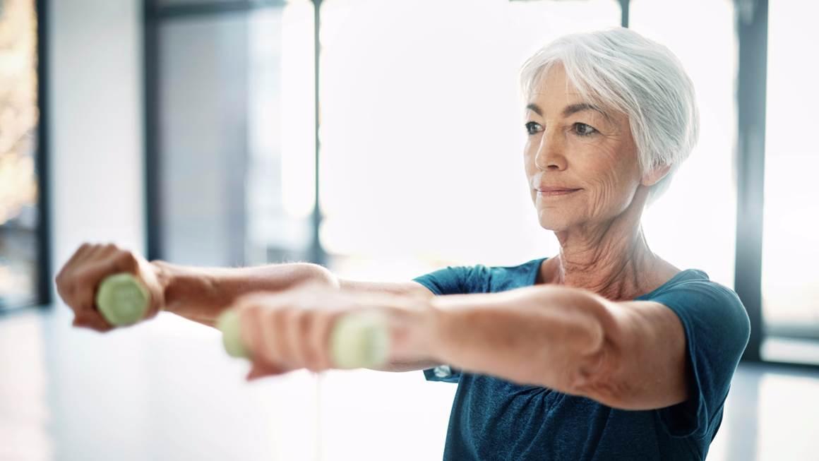 Senior woman lifting weights
