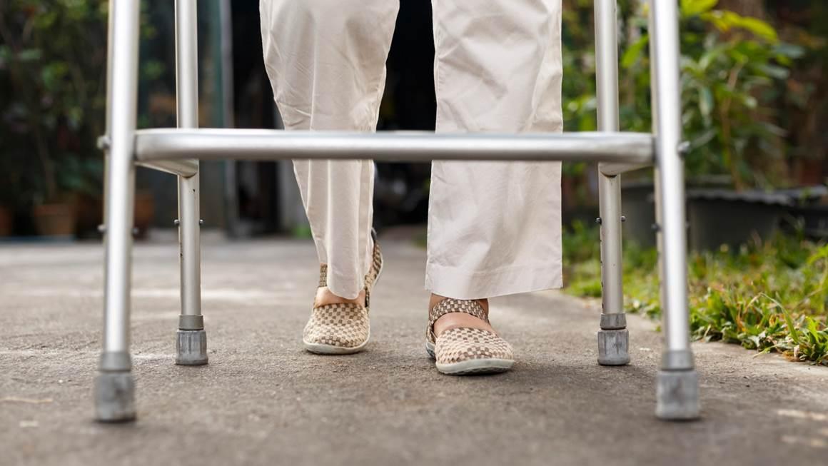senior woman walking with walker