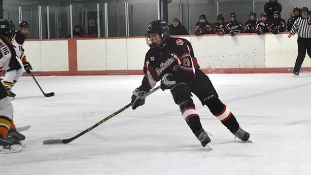 Tobey Lawson playing hockey