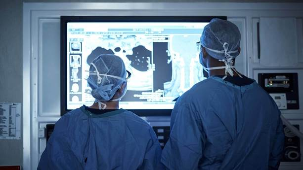 Two doctors reviewing a patients medical scan