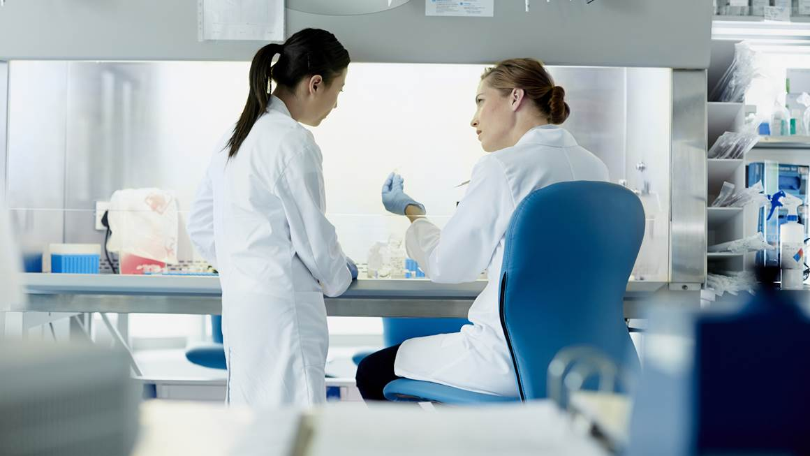 Two female researchers working in lab