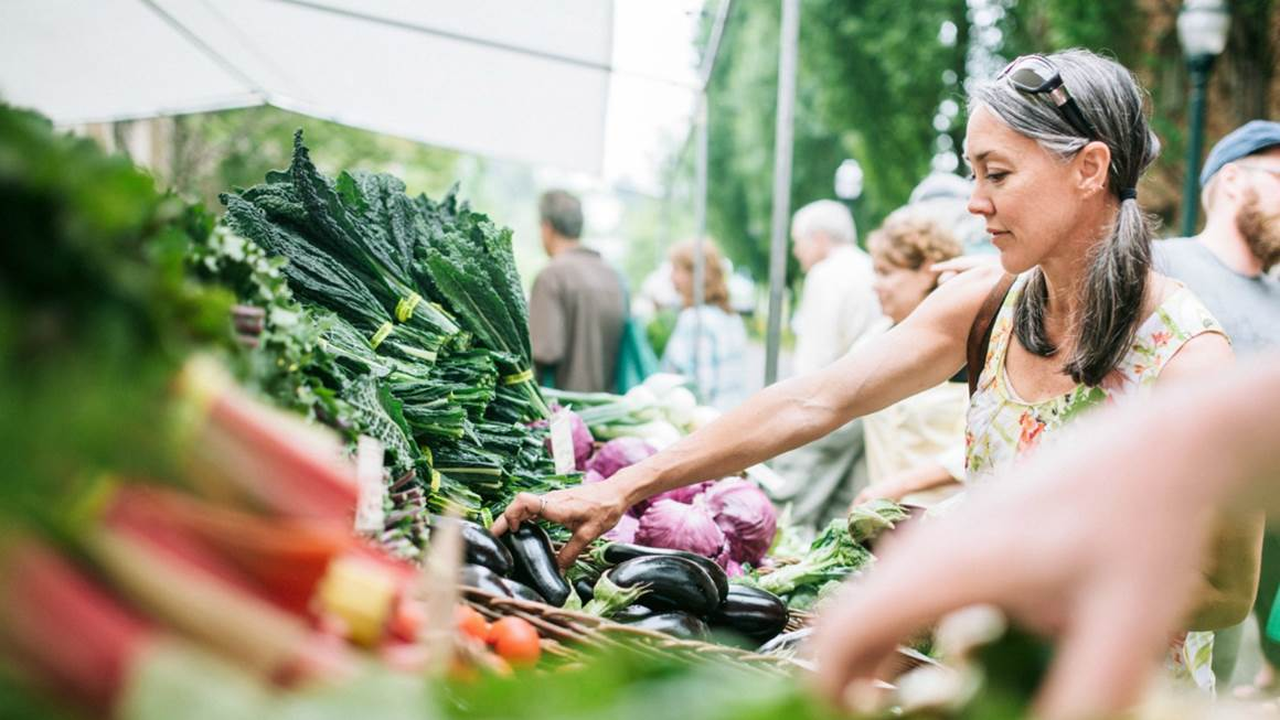 Woman shopping for vegetables at farmer