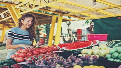 Young woman shopping at farmer