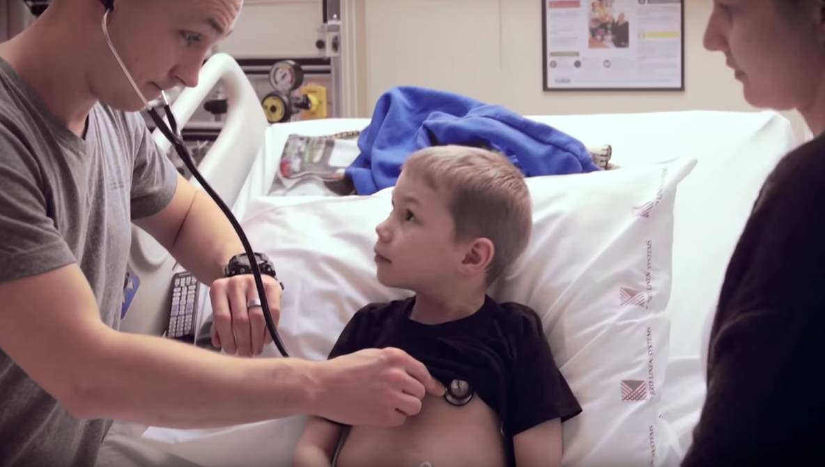 Boy getting checked by Doctor