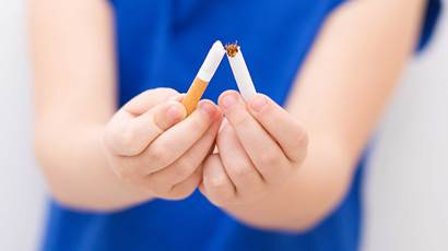 Closeup of girl breaking cigarette