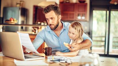 Man sitting with daughter at a computer