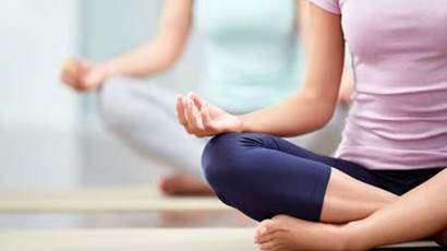 Young people do yoga indoors