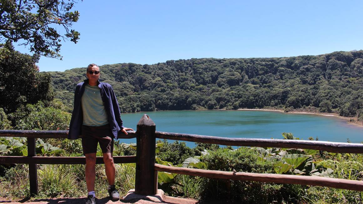 Praveen Varshney standing by a lake