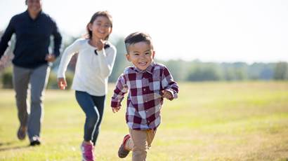 young boy girl and father running outside