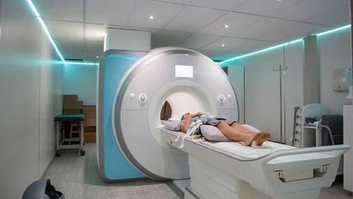 Person entering MRI machine.