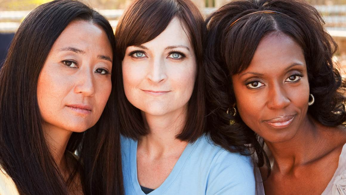 Three women of different races in close up