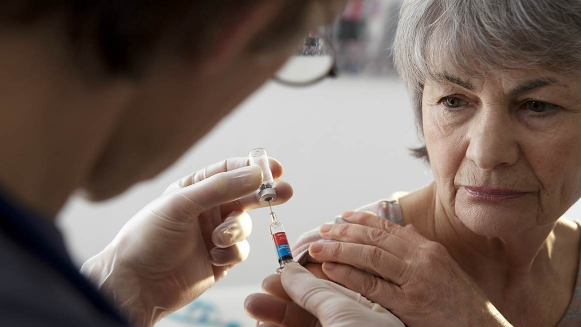 A woman is pictured preparing for a vaccination