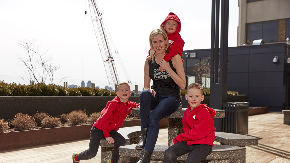 Young mother and her three boys posing outside in Heart & Stroke branded clothing