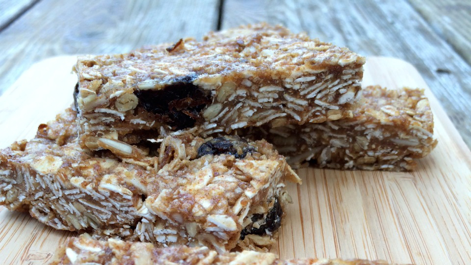 Almond oat bars served on a wooden cutting board