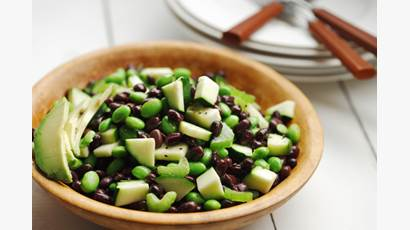 Black bean and edamame avocado salad in a wooden bowl