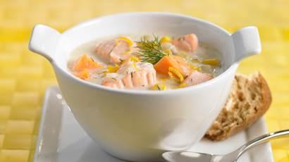 Corn sweet potato and salmon chowder in a white bowl