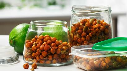 Two glass jars filled with crispy chickpeas, lime in background.