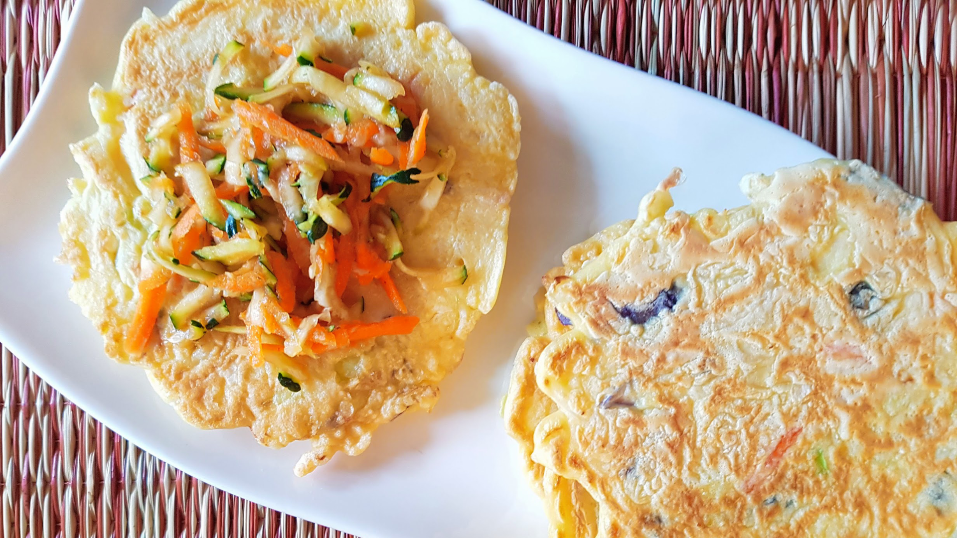 Two Japanese inspired savoury pancakes on a plate