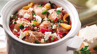 Mediterranean chicken with feta topping in a white crock pot