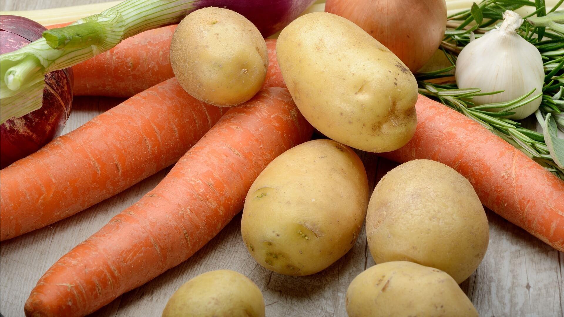 Raw carrots, potatoes and garlic