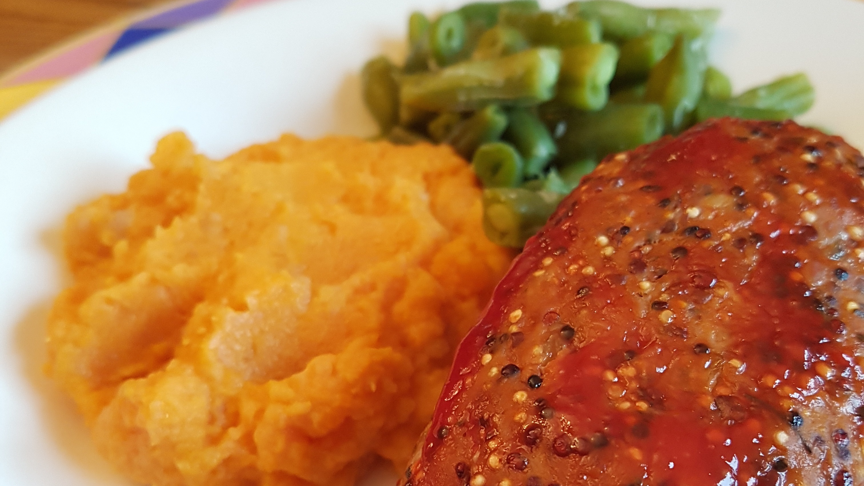Turkey meatloaf with green beans and sweet potato mash on plate