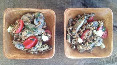 Two square bowls of farro and mushroom salad
