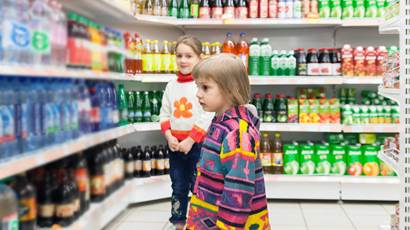Little girls choosing products in supermarket