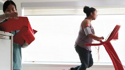 Woman running on a treadmill with wires connected to her