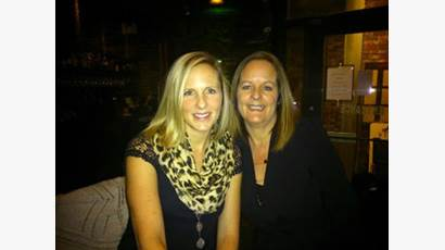 Jackie Evans with her adult daughter smiling
